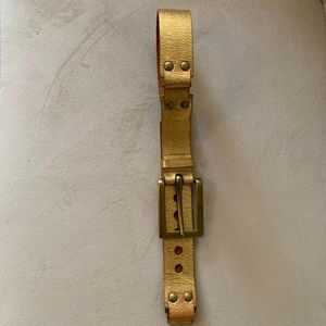 Wide gold leather belt